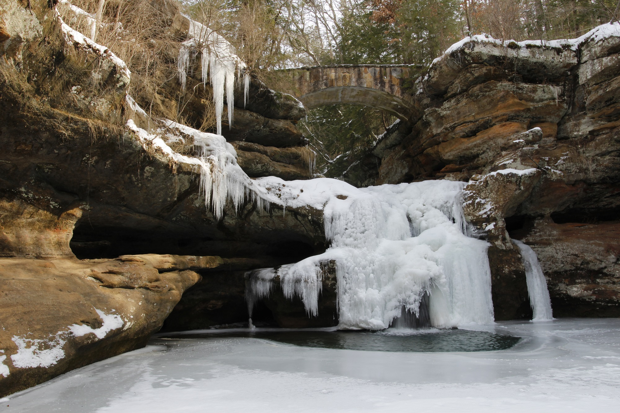 frozen waterfall winter hike hocking hills state park logan ohio